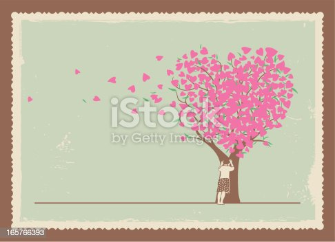 istock Frame of girl leaning on a tree with heart shaped leaves 165766393