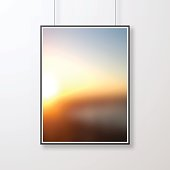 Realistic frame in vertical position and with an abstract background, blurred sunset, isolated on white background.