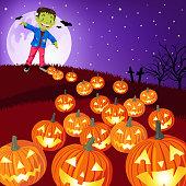 Teenage boy dress up frankenstein costume walking dead along with the jack o'lantern