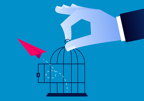 Freedom, the red paper airplane flies out of the cage opened by the giant