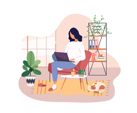 Freelancer working on laptop at home, remote job.