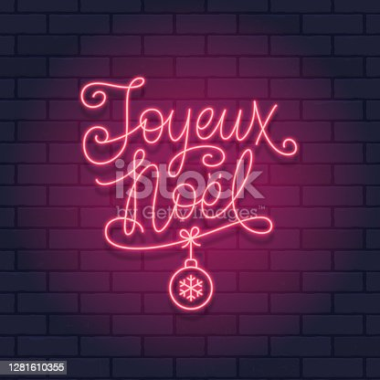 istock French Christmas red neon light sign on a brick wall dark background. Joyeux Noel calligraphic greeting design. Vector illustration. 1281610355