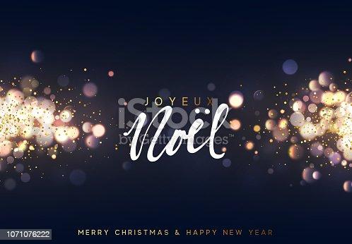 istock French Joyeux Noel. Christmas background with golden lights bokeh. Xmas greeting card. 1071076222