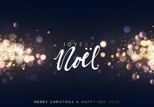 French Joyeux Noel. Christmas background with golden lights bokeh. Xmas greeting card.