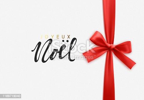 istock French lettering Joyeux Noel. Merry Christmas Holiday background. 1169719040