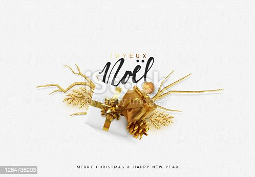 istock French text Joyeux Noel. Christmas bright background with golden decorations. Xmas greeting card. Happy New Year. Festive objects in the form of border gold gifts box, bauble balls. 1284738203