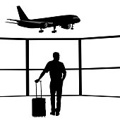 Business traveller is watching the planes land and take off at the airtport.  Silhouette illustration