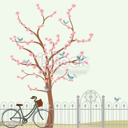 An elegant tree full of cherry blossoms - and little blue birds - with an iron fence and euro-style bicycle. (Includes .jpg)