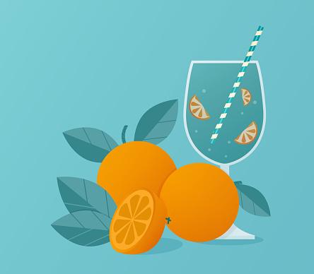 Fresh orange juice in glass with oranges