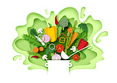 istock Fresh vegetables falling into the pot, vector layered paper cut style illustration 1266921471