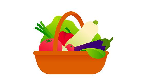 Fresh vegetables in wicker basket. Straw basket with harvest from the garden.