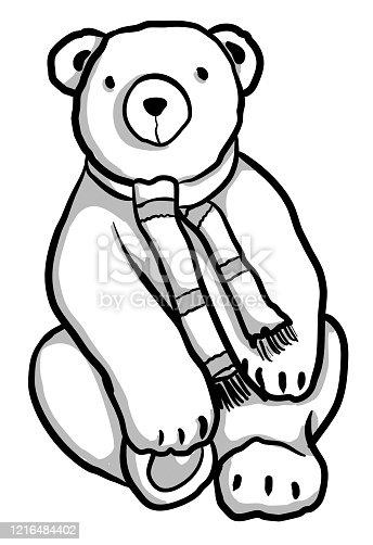 A plush toy bear wearing a scarf