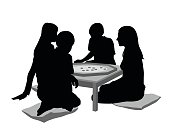 Silhouette illustration of kids playing a board game