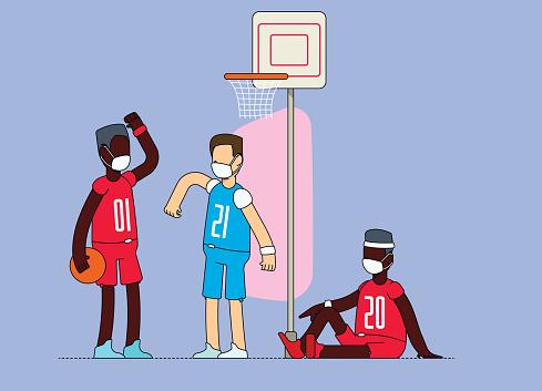 Friends bumping elbows before playing basketball. People wearing mandatory mask.
