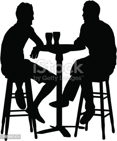 Silhouette of two men chatting and having drinks at a bar table, with two glasses on the table.