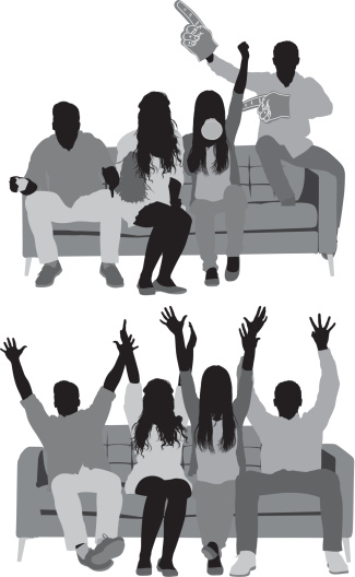 Friends sitting on couch and watching football match