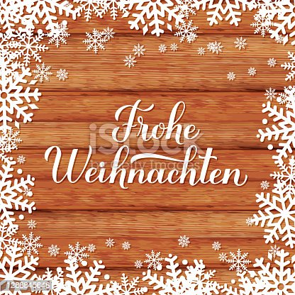 istock Frohe Weihnachten calligraphy hand lettering on wood background with snowflakes. Merry Christmas typography poster in German. Vector template for greeting card, banner, flyer, sticker, etc. 1286845646
