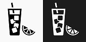 Fruit Juice Icon on Black and White Vector Backgrounds. This vector illustration includes two variations of the icon one in black on a light background on the left and another version in white on a dark background positioned on the right. The vector icon is simple yet elegant and can be used in a variety of ways including website or mobile application icon. This royalty free image is 100% vector based and all design elements can be scaled to any size.