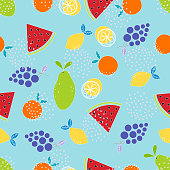pattern with fruits on blue, wallpaper with slices of watermelon, orange, lemon, papaya and grapes, fruit background