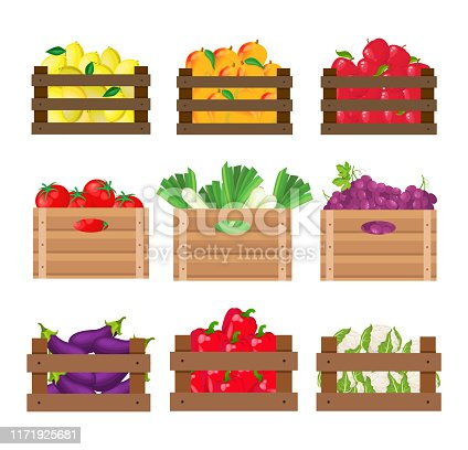 Set of fruits and vegetables in wooden crates on white background