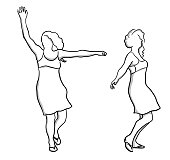 Middle aged woman dancing freely and twirling