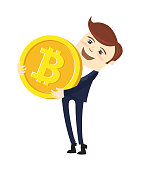 Funny businessman holding Bitcoin. Physical bit coin digital currency cryptocurrency