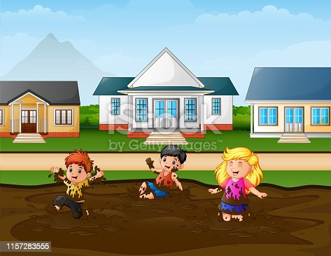 Funny children playing a mud puddle in the rural background