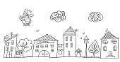 Funny children's drawing of the street with small cute houses. Hand drawn sketch in doodle style.