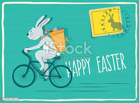 funny easter bunny biking with pannier filled with easter eggs