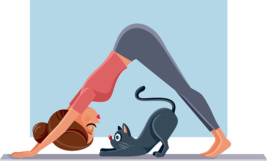 Funny Girl Exercising Next to Her Cat on Yoga Mat