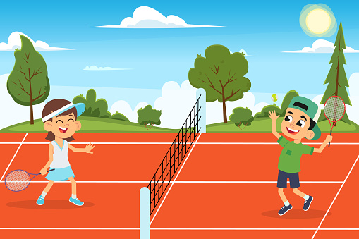 funny kids play tennis on the open court.
