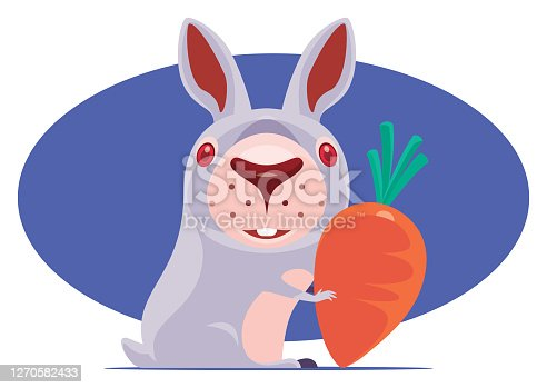 istock funny rabbit holding carrot 1270582433