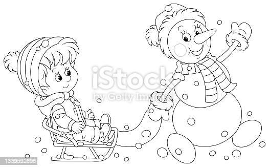istock Funny snowman sledding a happy little boy 1339592696