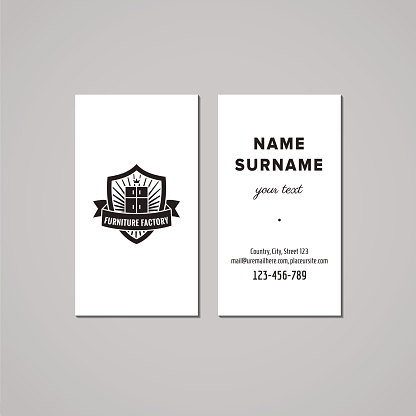 Furniture business card design concept. Logo with wardrobe and shield.