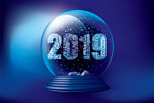 Futuristic Christmas snow globe with falling snow and night city in 2019 from inside. Editable vector illustration.