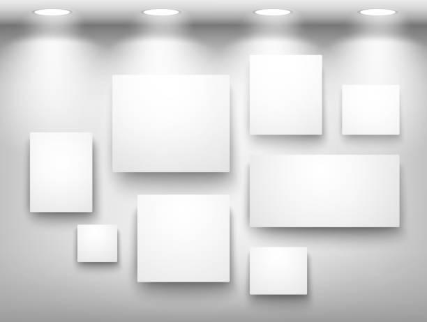 gallery of empty frames on wall with lighting - 美術館点のイラスト素材/クリップアート素材/マンガ素材/アイコン素材