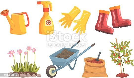 Garden tools and equipment for plant and water trees and flowers. Wheelbarrow with soil, working rubber gloves and boots, watering can, bag with fertilizers, spray for control of insects