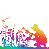 Woman working in her flower bed  in saturated rainbow gradient colours