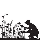 A vector silhouette illustration of a woman crouched down to tend to her flowers in her garden.