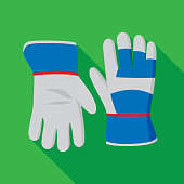 Vector illustration of gardening gloves against a green background in flat style.