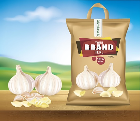 Garlic head packaging is placed on a wooden floor. with fresh garlic