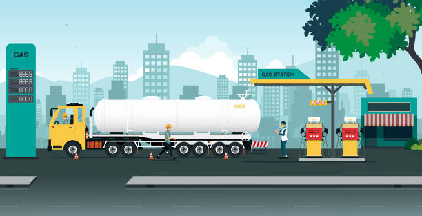 gas station The truck is transferring oil at a station that is inspected by employees. station stock illustrations