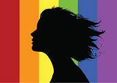 Girls profile on front of a rainbow flag.