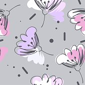 Gentle airy flowers in pink, gray, white and purple colors seamless pattern on gray background.