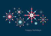Geometric snowflakes background with greetings. Christmas, Holiday greeting card with simple geometric shapes. Stylized snowflakes. Scandinavian style.