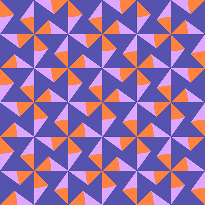 Geometric triangle seamless pattern in purple, pink and orange colors.