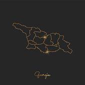 Georgia region map: golden glitter outline with sparkling stars on dark background.