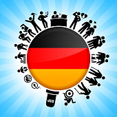German Flag on Human Life Cycle Background. The main circular object is surrounded by the human lifecycle images. The individual illustrations show the stages of human life from conception to death. They are rendered in black color and go all the way around the circle.