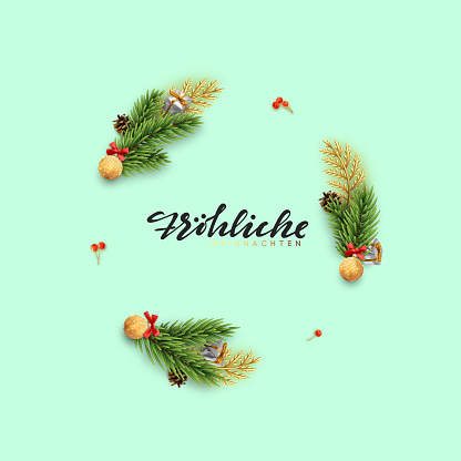 German text Frohliche Weihnachten. Christmas background of a circular frame with pine branches and xmas balls.