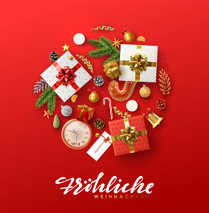 German text Frohliche Weihnachten. Christmas greeting card with holiday objects.